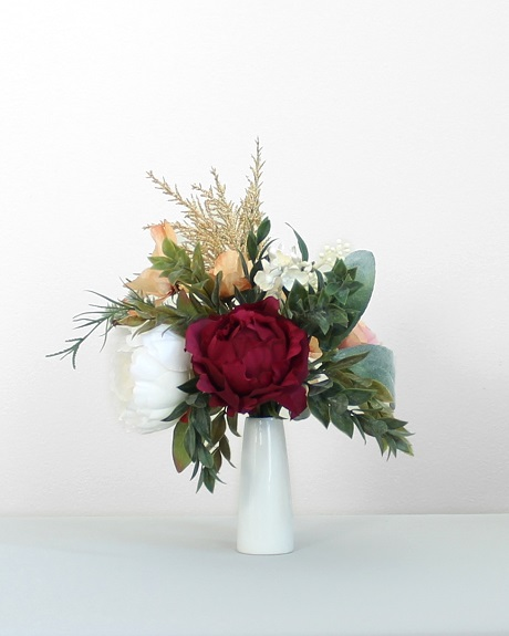 Artificial wildflower centerpiece with faux roses and eucalyptus