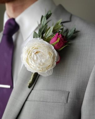 White ranunculus boutonniere from the Vienna Collection