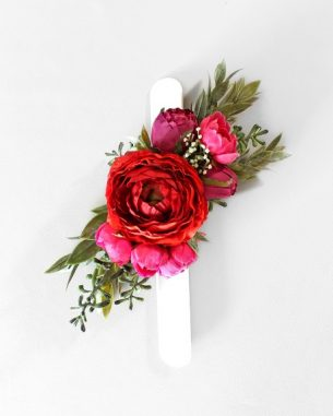 Big fake flower wrist corsage with roses and ranunculus