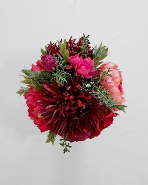 Large Vienna centerpiece including burgundy mums, pink peonies, and pink roses.