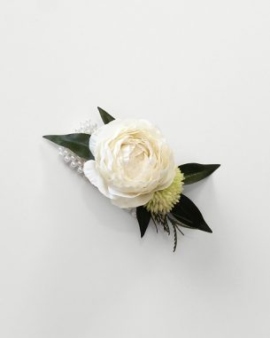 White ranunculus wrist corsage from the Nottingham Collection