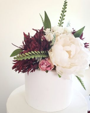 Ivory and burgundy faux flower cake topper from the Brooklyn Collection