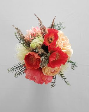 Bright orange poppies and pink peonies in a large centerpiece from the Santiago Collection