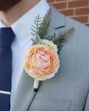 Orange ranunculus silk boutonniere from the Santiago Collection