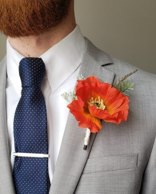 Bright orange poppy boutonniere from the Santiago Collection