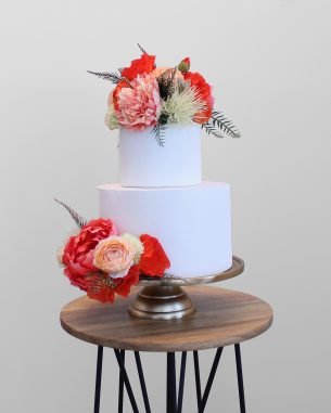 Bright orange and pink faux flower cake topper from the Santiago Collection