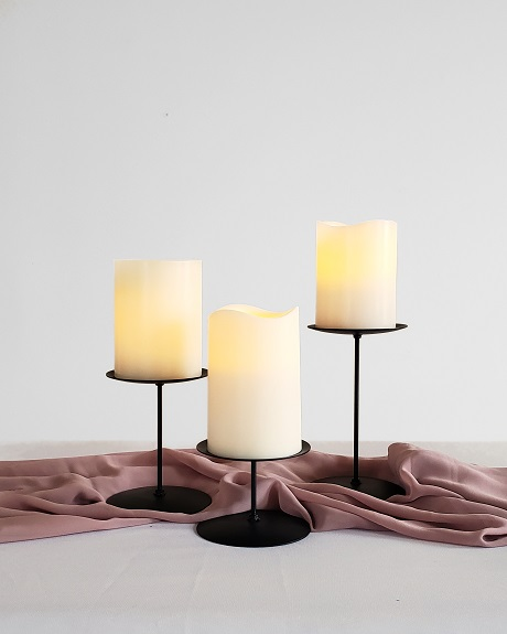 Black pillar candle holders with LED candles for rent