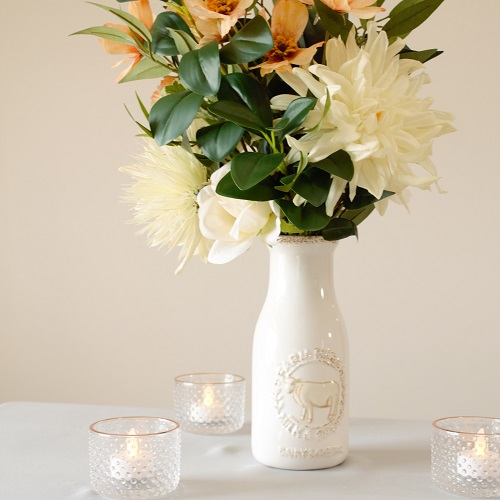 The Sydney Collection, featuring silk dahlias, watercress, anemones, and ivory roses.