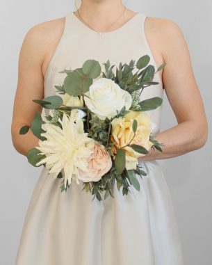 Artificial yellow roses and white dahlias with fake silver dollar eucalyptus in the Sumatra bridesmaid bouqet