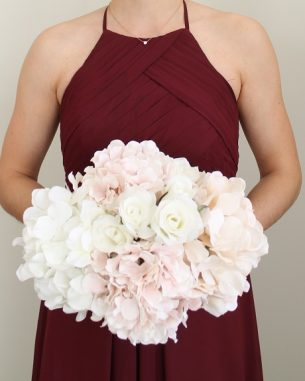 Artificial hydrangeas and roses in a rent-and-return bridesmaid bouquet