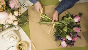 Woman cutting the ends of fresh floral stems
