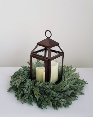 Bronze lantern with three LED candles inside and a faux wreath