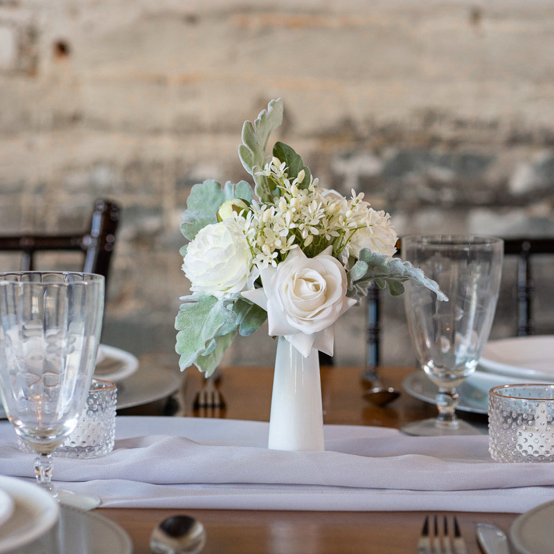 A white rose and dusty miller centerpiece from the Florence Collection.