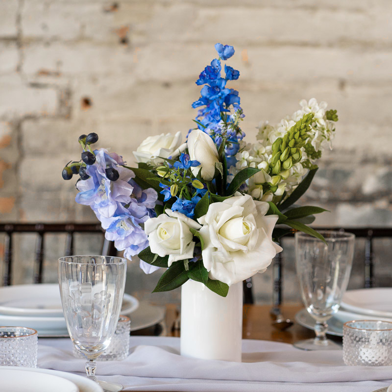A bluebell and blue delphinium centerpiece from the Juneau Collection.
