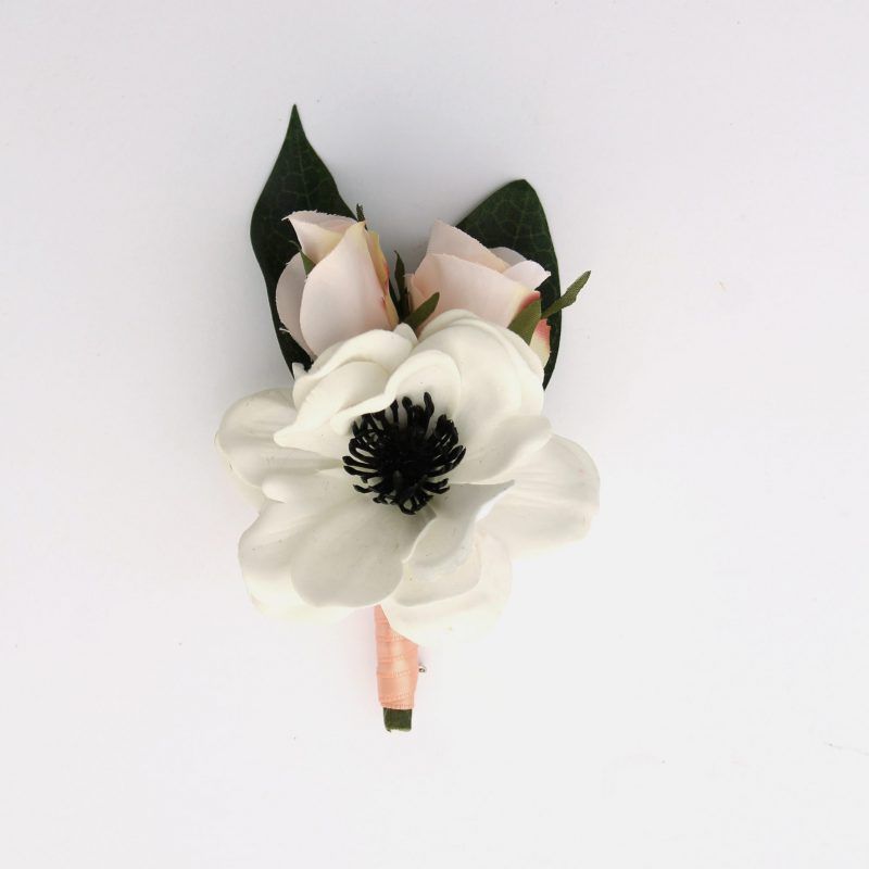 An anemone and pink rose boutonniere from the Kyoto Collection.