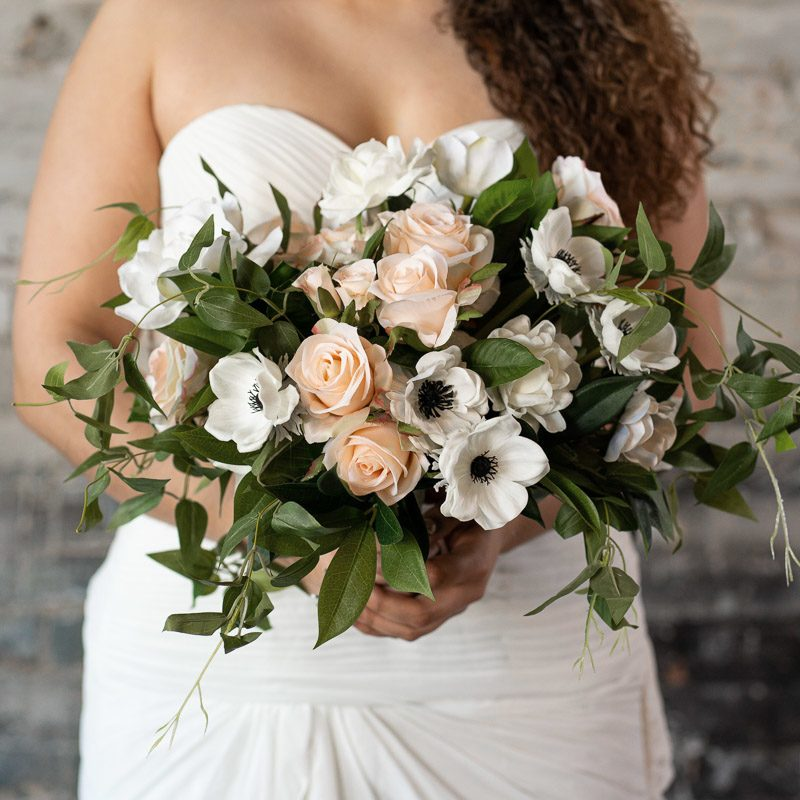 A bridal bouquet with white anemones, gardenias, and pink roses from the Kyoto Collection.