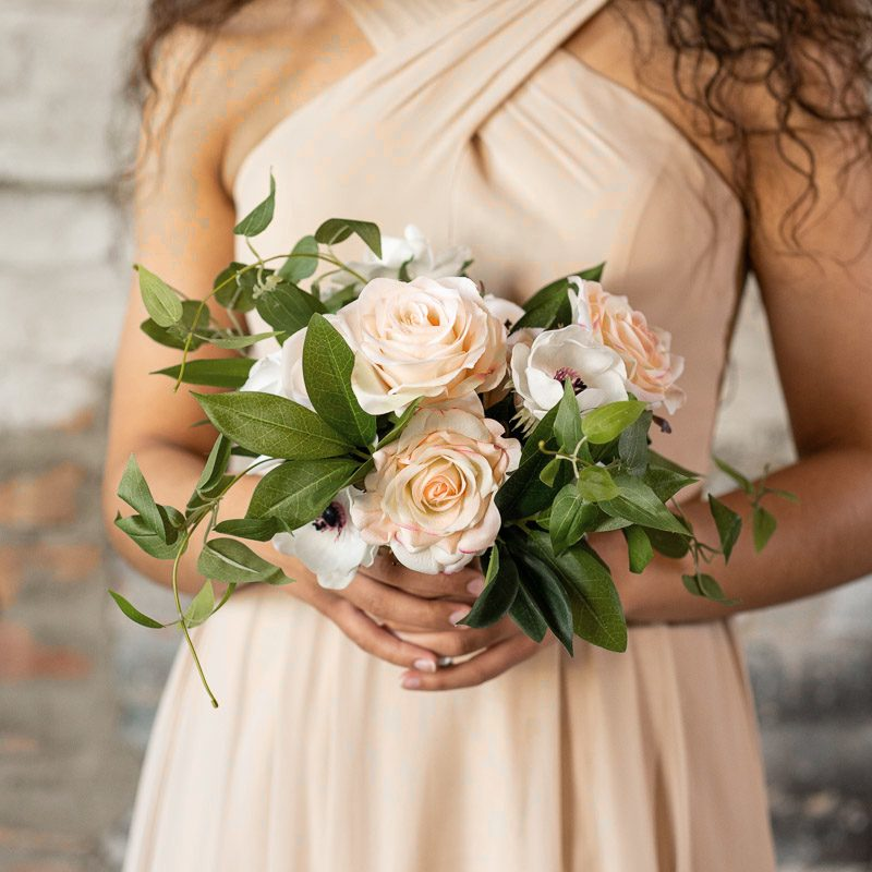 A bridesmaid bouquet with white anemones, gardenias, and pink roses from the Kyoto Collection.