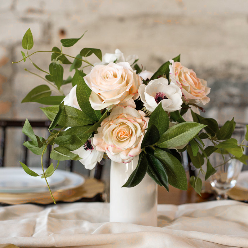 A floral centerpiece with white anemones, gardenias, and pink roses from the Kyoto Collection.