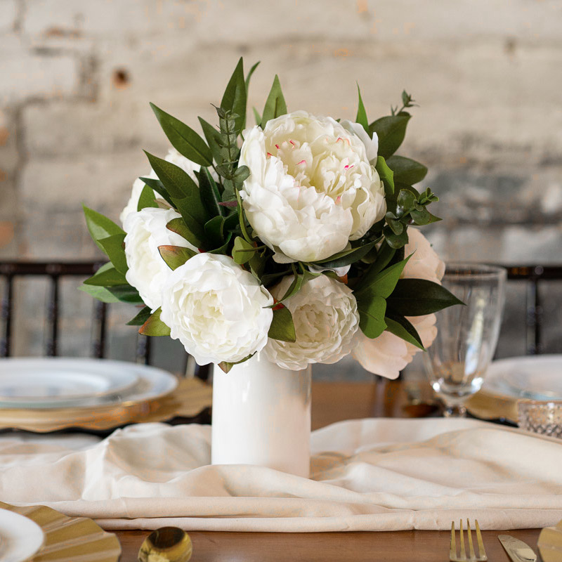 A white peony centerpiece from the Lhasa Collection.