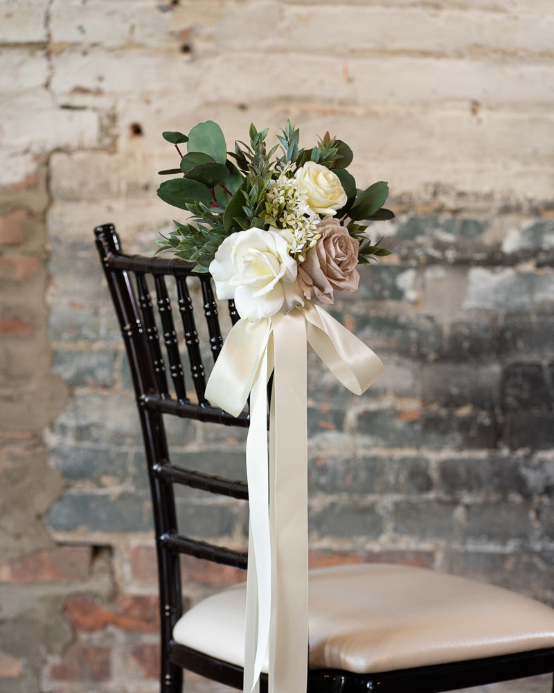 An aisle marker with white roses and mauve peonies from the Montreal Collection.