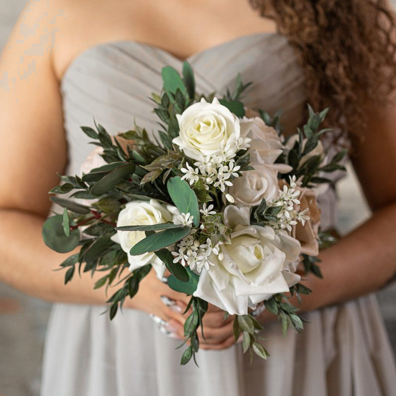 A bridesmaid with a mauve peony and white rose bridal bouquet from the Montreal Collection.