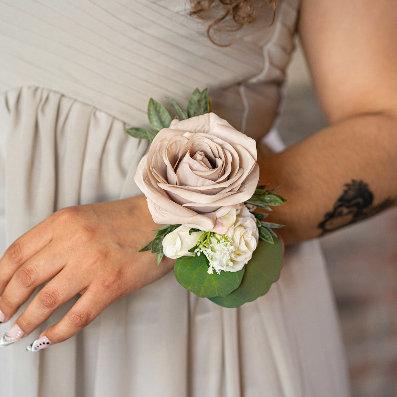A mauve rose corsage from the Montreal Collection.