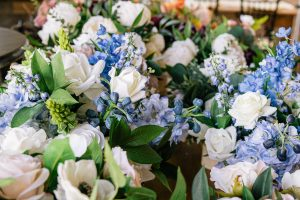 Close up of bluebells and white roses in a faux flower bouquet